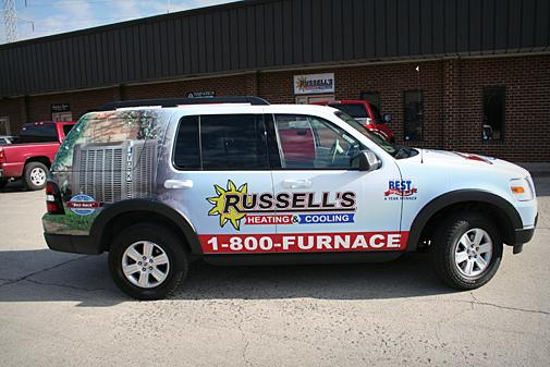 White SUV with Russell's logo on the side